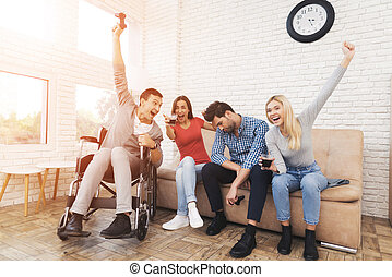 Two guys and two girls play on the game console.