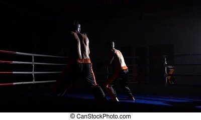 Two guys are preparing for kickboxing competitions. Slow...