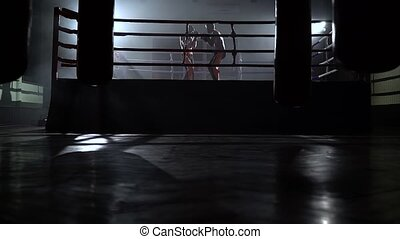 Two guys compete in a sports ring