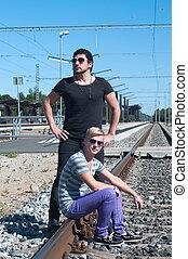 Two guys on train tracks