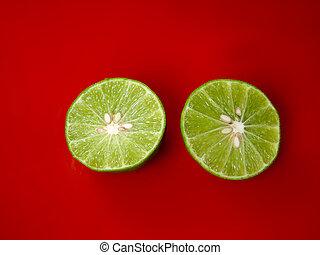 Two half of Lime green hemispherical drop on the ground orange