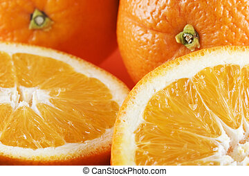 Two half oranges, two whole oranges - Horizontal photo of...