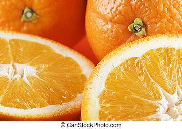 Two half oranges, two whole oranges - Horizontal photo of...