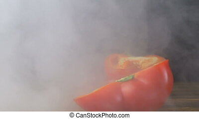 two halves of a cut red sweet bell pepper or capsicum are on...