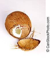 Two halves of coconut on white background
