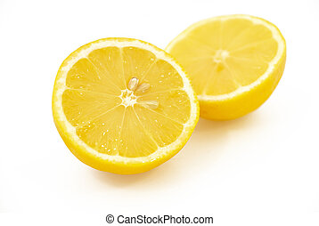 Two halves of lemon on a white background