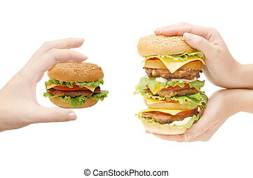 Two hamburgers in hands isolated on white