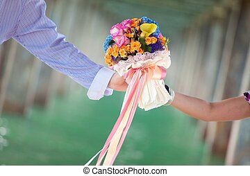 hand holding beautiful flower bouquet
