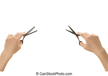 Two hand holding different hair scissors