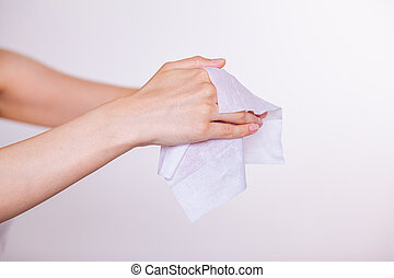 Two hands cleaning with wet wipes