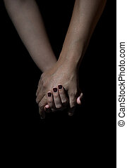 two hands of love people holding on a black background