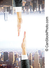 Two hands on city background