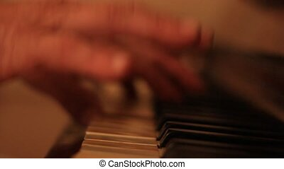 Two hands playing on a beautiful gr