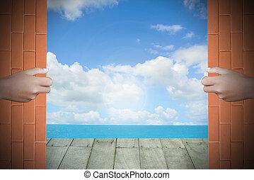 Two hands to open the door sea background