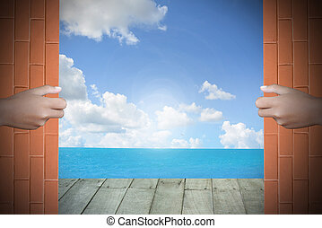 Two hands to open the door sea background