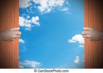 Two hands to open the door sky background