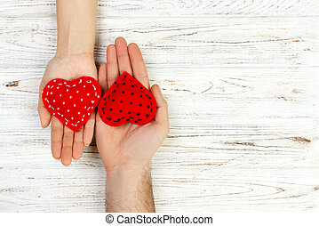 Two hands with a heart on a white background. Valentine's Day copt space