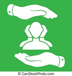 two hands with group of businessman icon on a green background -