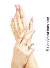 two hands with pink acrylic nails over white