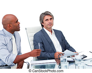 Two handsome businessmen having a meeting