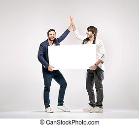 Two handsome friends giving each other a high-five - Two ...