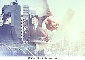 Online business - Two handsome young men shaking hands and...