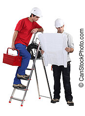 Two handymen working together