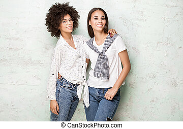 Two happy african american girls posing.