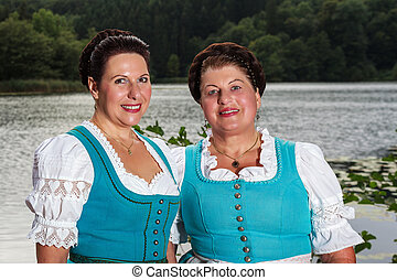Two happy Bavarian ladies in dirndl