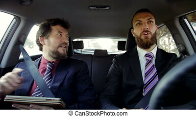 happy business men laughing driving