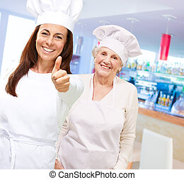 Two Happy Chef Showing Thumb Up Sign
