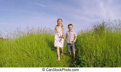 Two happy children playing on the road at the day time.
