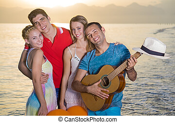 Two Happy Couples at the Beach on Sunset