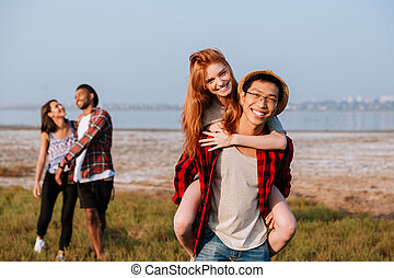 Two happy couples having fun outdoors
