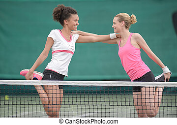 two happy female tennis player