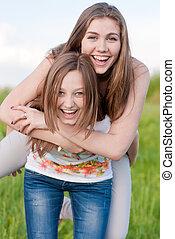 Two happy friends having fun