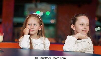 Two happy girl loking at camera