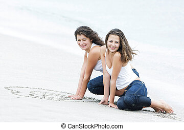 two happy girls on beach