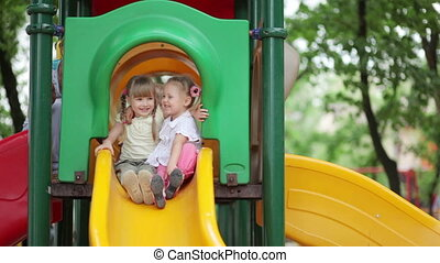 Two happy girls on the playground