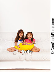 Two happy girls with pillows