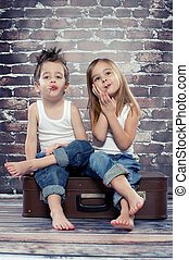Two happy kids in studio
