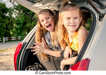 two happy kids in the car