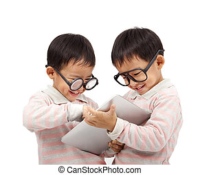 two happy kids using touch pad computer and isolated on...