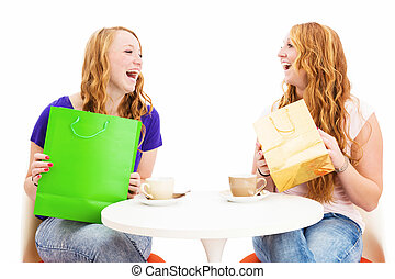 two happy laughing women with shopping bags