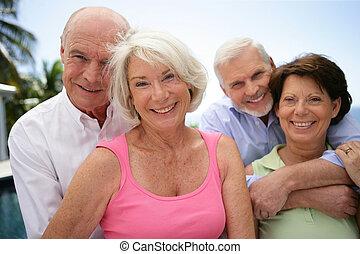 two happy senior couples
