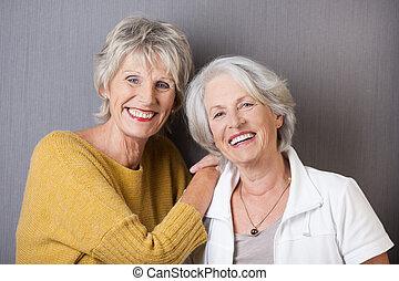 Two happy senior ladies - Two happy vivacious senior ladies...
