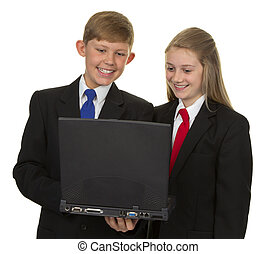 Two Happy Students Using Laptop