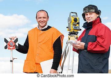 surveyor workers with theodolite equipment