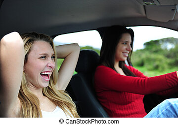 two happy women in a car