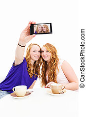two happy women making photos of themselves